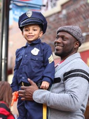 Jay Oliver and son Miles, 4, from Elmwood Park, N. J. get ready to watch the Nyack Halloween Parade on Saturday, October 29, 2016.