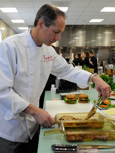 Brian Kolodziej, Senior Manager of Culinary for Chick-fil-A, makes the company's new grilled chicken club sandwich at The Bench Top area of the Chick-fil-A headquarters. The Bench Top is where development and prototyping work is done by product developers and chefs.
