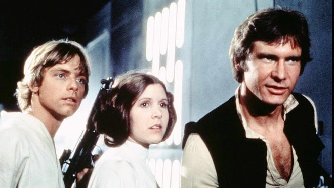 "Luke Skywalker (Mark Hamill), left, Princess Leia (Carrie Fisher) and Han Solo (Harrison Ford) searching for an escape route on the maze-like Imperial Death Star in ""Star Wars Special Edition."" (GNS Photo from Twentieth Century Fox)"