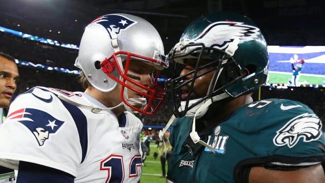 New England Patriots quarterback Tom Brady (12) greets Philadelphia Eagles defensive tackle Fletcher Cox (91) after Super Bowl LII at U.S. Bank Stadium.
