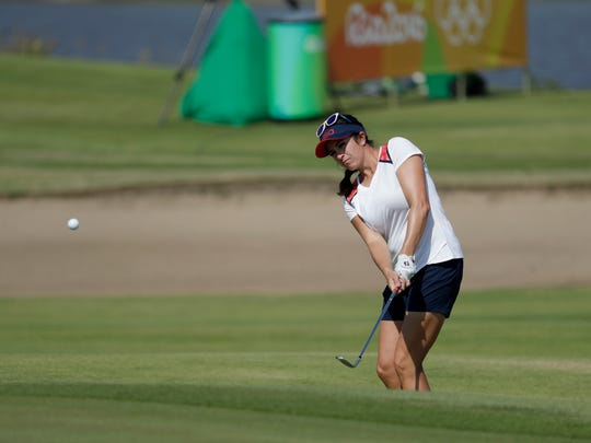 Gerina Piller of the United States chips to the green on the fifth hole during the first round of the women's golf event Wednesday at the 2016 Summer Olympics in Rio de Janeiro.