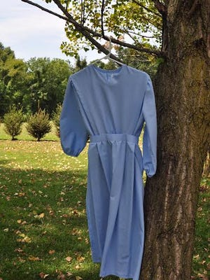 This is the new dress Gloria made to wear to attend her friend's wedding.