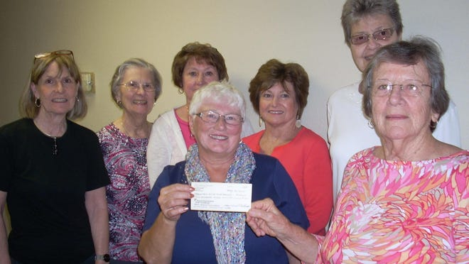 The Women of St. Andrew's Episcopal Church recently recently donated $1,250 to Mountain Home Food Basket. The women raised $1,000 of the donation for the Spring Fling Luncheon, and it was augmented by a $250 grant from Thrivent Financial. Shown are, first row, from left, Anna Mattson, Twin Lakes Chapter of Thrivent Financial board member and Kathy McClellan of the Mountain Home, second row, Sally Soderblom, Ellen Pugh, Deanna Van Eps, Roxanne Friend and Donna Stading, Women of St. Andrew's Episcopal Church members.