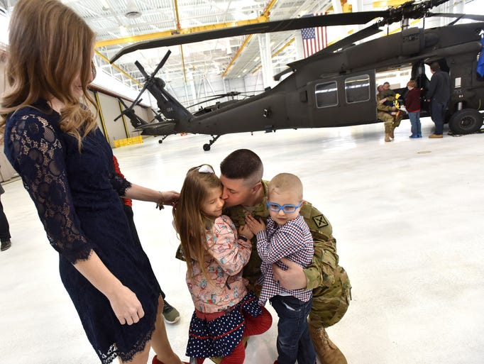 Capt. Bryan Shook hugs and says goodbye to his family,