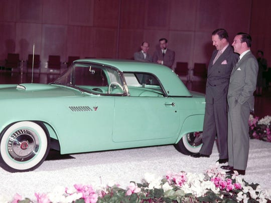 Henry Ford II and William Clay Ford with a 1955 Ford Thunderbird in Dearborn in 1954.