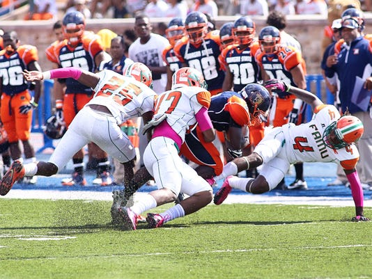 Akil Blount makes a tackle.jpg