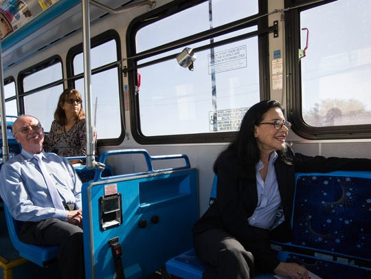 City Councilors Yvonne Flores, right and Jack Eakman, left, and Ceci Vasconcellos, take a short bus ride around downtown Las Cruces during the Free Fare Day, Thursday June 21, 2018.