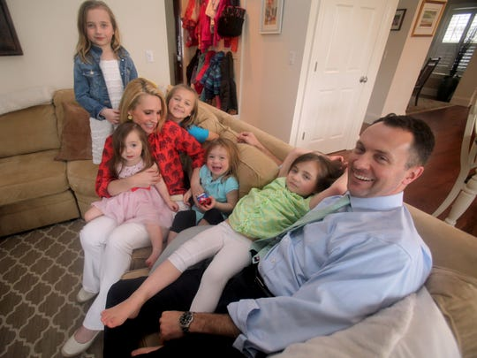 Andrea Canning, a correspondent for NBC News, with her husband Tony Bancroft, and their five daughters Anna, 8, Charlie, 5, Kiki, 4, Georgia, 3, and Elle, 1, together in their Rye home April 7, 2017.