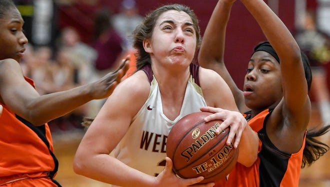 Webster County's Karlie Keeney (3) splits Hopkinsville's Lakayla Samuel (4)  and Hopkinsville's Breon Oldham (5) as the Webster County Lady Trojans play the Hopkinsville Lady Tigers in the Second Region semifinals in Dixon Friday, March 2, 2018.