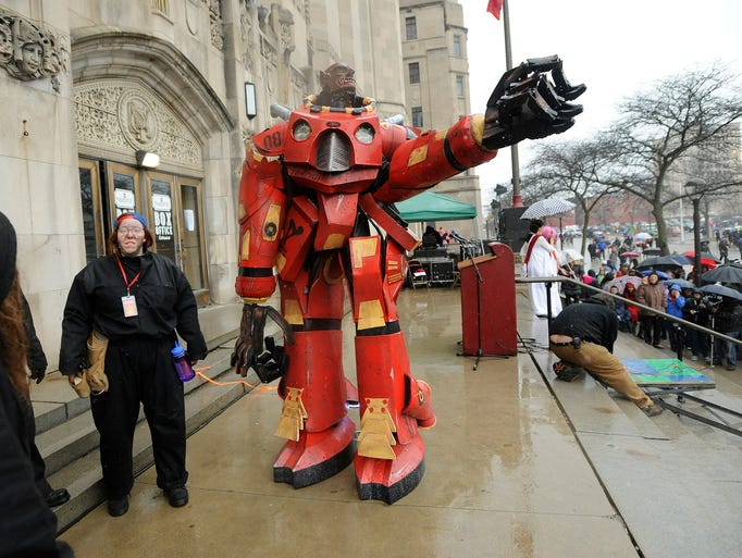 The Nain Rouge taunts the crowd at the Masonic Temple