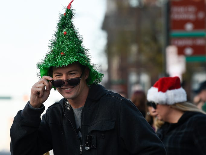 John Linton wears a Christmas Tree hat as he looks