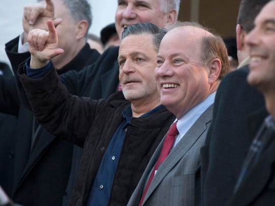 Dan Gilbert, Bedrock founder, left, and Detroit Mayor