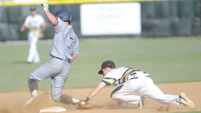 Abilene High second baseman Zach Bollinger, right, tags out Keller's Matt Cavanagh, who was trying to steal second in the fifth inning. Keller beat AHS 10-0 in the District 3-6A game Tuesday, April 18, 2017 at Blackburn Field.