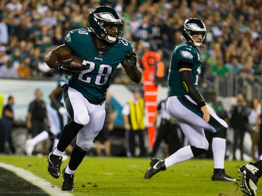 Eagles' running back Wendell Smallwood runs out of the end zone during the first quarter of their game against the Redskins Monday night at Lincoln Financial Field.