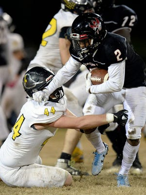 Pearl-Cohn running back Jimmyrious Parker (2) darts past Fairview linebacker K.K. McKinney (44) during the second half of a quarterfinal playoff game Friday.