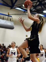 Audrey Spiker goes up for a layup during Tri-Valley's