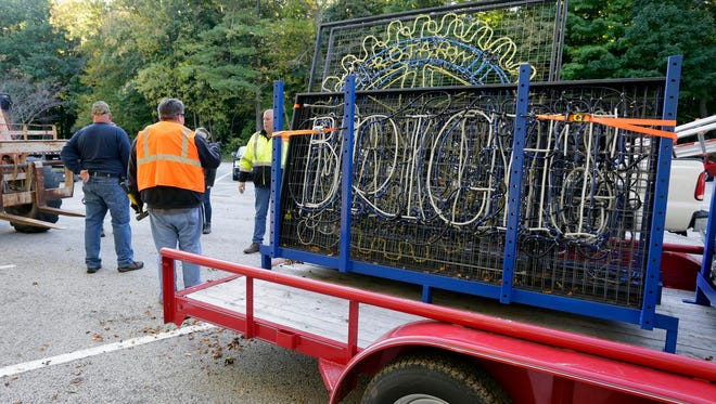 Rotary volunteers stand by a trailer with lights to be put up for Making Spirits Bright this holiday season Saturday October 8, 2016 at Evergreen Park in Sheboygan.
