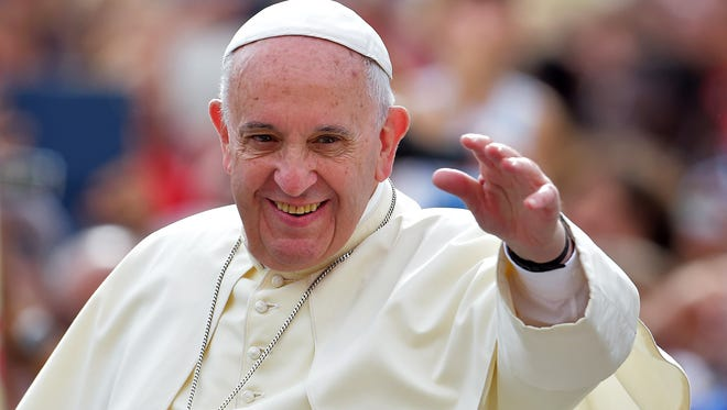 Pope Francis waves to faithful upon his arrival on St. Peter's square at the Vatican to lead his weekly general audience on Sept. 16. He'll visit New York City on Sept. 24-25.