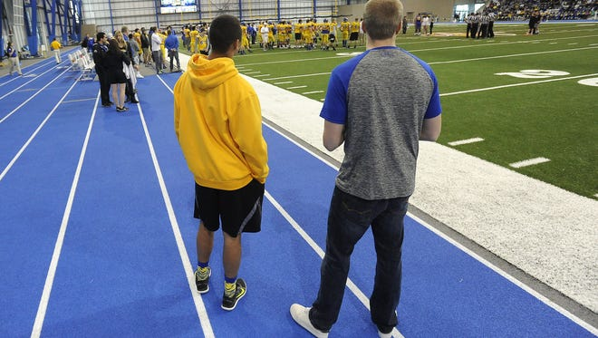 Taryn Christion and Tyler Van Voorst attend the SDSU spring football game at the Sanford Jackrabbit Athletic Complex in Brookings, S.D., Saturday, April 25, 2015. Christion and Van Voorst will play football in the fall at SDSU.
