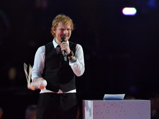 Ed Sheeran with his Best Male Solo Artist Award at