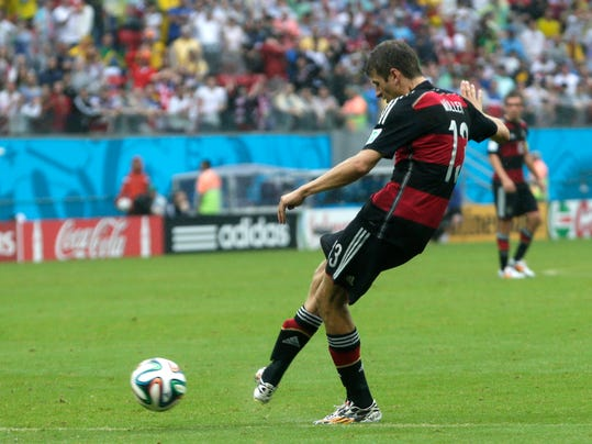 Germany's Thomas Mueller scores the opening goal during the group G World Cup soccer match between the USA and Germany at the Arena Pernambuco in Recife, Brazil, Thursday, June 26, 2014. (AP Photo/Petr David Josek)
