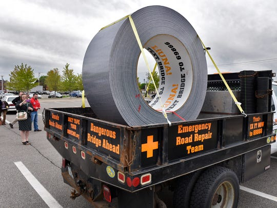 A large roll of duct tape was used as a backdrop for a rally by transportation funding advocates Wednesday at the St. Cloud Public Library. The rally was organized by Move MN to protest the lack of a transportation funding package.