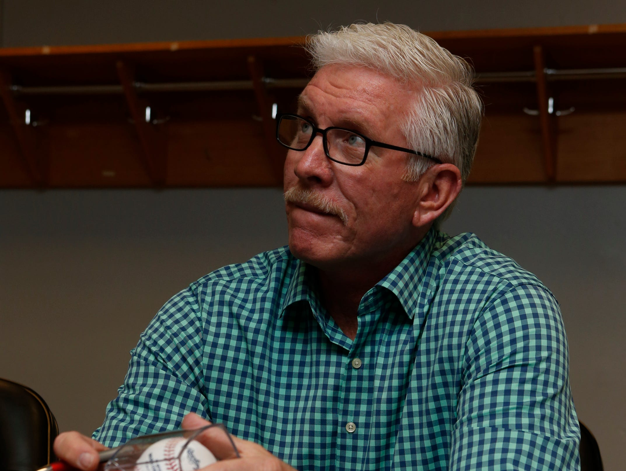 Mike Schmidt signs baseballs for raffle before the Delaware Sports Awards banquet at the Bob Carpenter Center Wednesday.