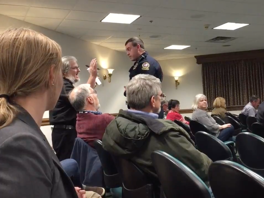 The Rev. Gregg Knepp, a senior pastor at St. Peter's Lutheran Church in Ocean City, protested from his seat, and was escorted from the meeting by a town police officer