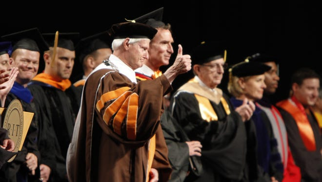 Bill Destler gives a big thumbs-up to the class of 2012.