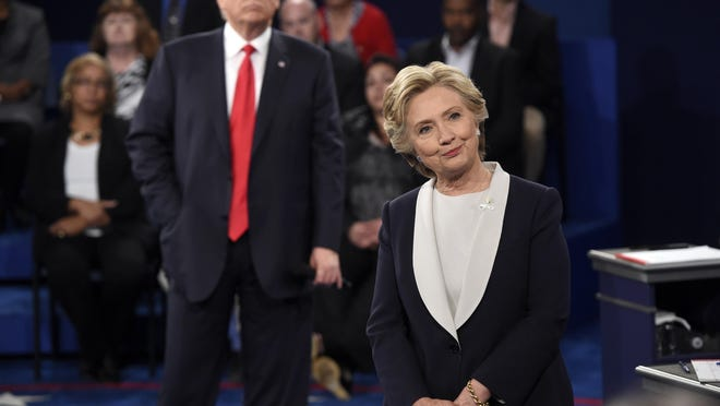 Democratic presidential nominee Hillary Clinton and Republican presidential nominee Donald Trump listen to a question during the second presidential debate on Oct. 9 at Washington University in St. Louis.