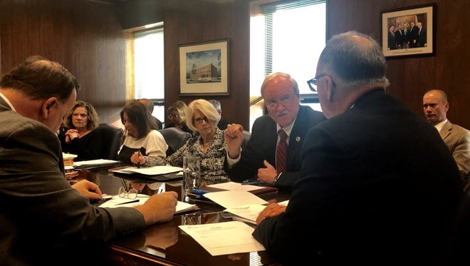 Ocean County Freeholder John C. Bartlett Jr. (center) gestures during a discussion of the proposed 2018 county government budget at an agenda session of the Board of Freeholders on Wednesday, Feb. 28, 2018 in Toms River.