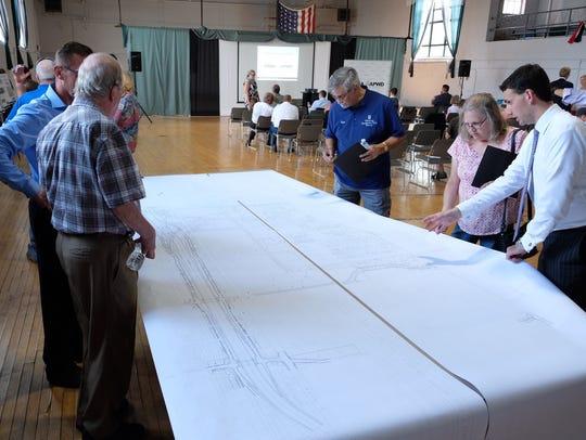 Residents overlook blueprint plans for the Gordie Howe