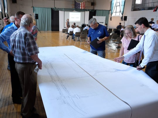 Residents overlook blueprint plans for the Gordie Howe