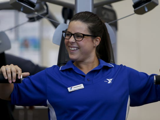 Samantha Schultz laughs as she uses one of the machines