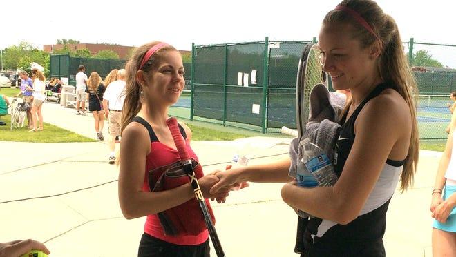 Denison Schleswig's Mara Pirscoveanu (left) and Glenwood's Jana King shake hands before their quarterfinal singles match. Pirscoveanu won 6-1, 6-0.