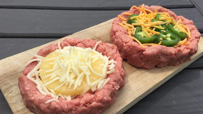 Burgers stuffed with mozzarella and pineapple, and cheddar and jalapeno.