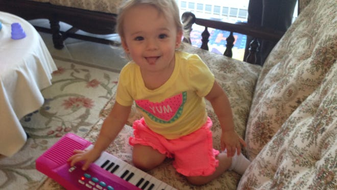 Isabella is learning all sorts of new skills as she nears her second birthday. She's already a better musician than her father.