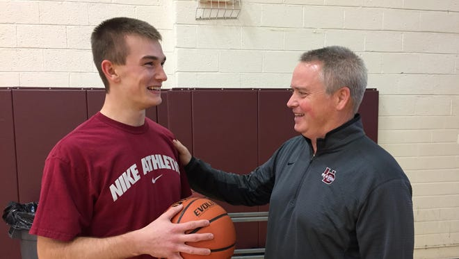 U-D Jesuit boys basketball coach Pat Donnelly talks with senior guard Scott Nelson at Monday's first official practice. The Cubs went 28-0 last season and won the Class A state title.