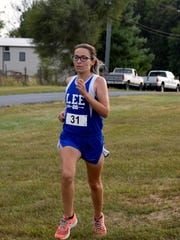 Robert E. Lee's Savannah Corbin finishes the girls race race during the Valley District mini-meet at the Rockingham County Fairgrounds in Harrisonburg, Va., on Wednesday, Sept. 21, 2016.