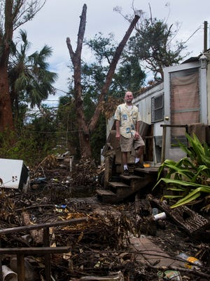 Darren Kingston stands outside of his mobile home, destroyed by Hurricane Irma, in Bonita Springs on Thursday, Oct. 05, 2017. Kingston, a Stage IV cancer patient, was given a place to stay by the Bonita Springs Assistance Office.