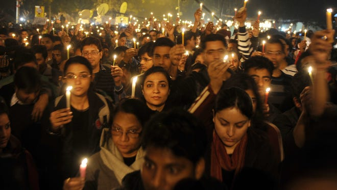 Indian protesters hold candles during a rally in New Delhi after the death of a gang rape victim from the Indian capital. India's Supreme Court stayed the death sentence of two of four men convicted of the fatal gang-rape of a student in New Delhi, an attack that shocked the country and sparked weeks of protests.