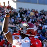 South squad wide receiver Kevin Norwood of Alabama (83) celebrates after scoring a touchdown against the North squad during the first half of a game at Ladd-Peebles Stadium.