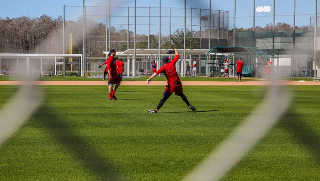 JetBlue Park is warming up for spring training to begin as the Red Sox players trickle in and begin practice and workers begin to set up the ball park.