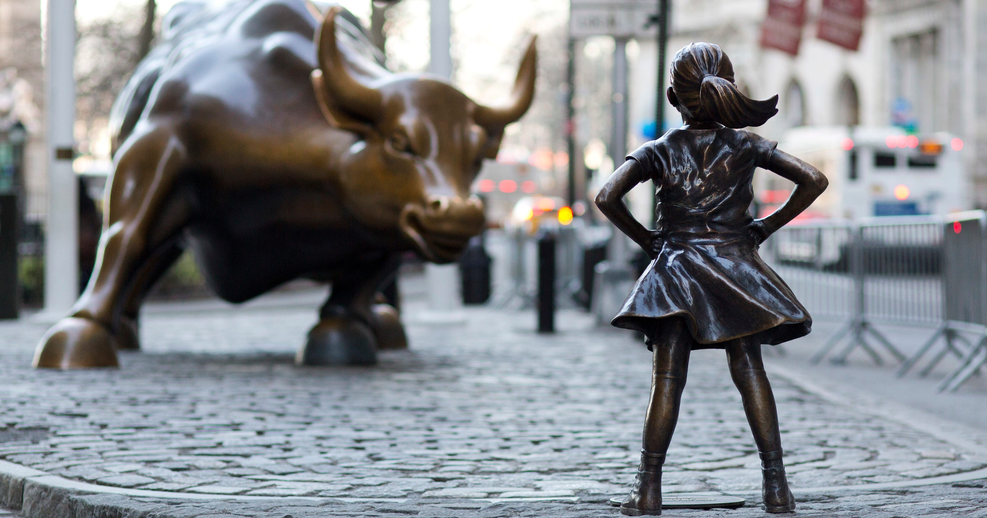Fearless Girl Statue Will Keep Staring Down Wall Street S Bull