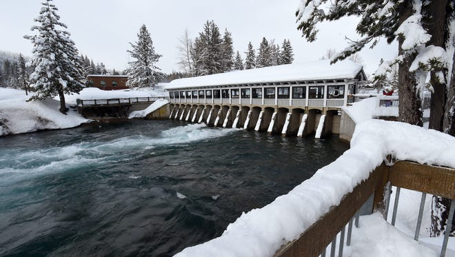 Water is seen flowing through the Lake Tahoe Dam and into the Truckee River at Tahoe City on Feb. 23, 2017. Thanks to a snowpack that's at more than 200 percent of normal Lake Tahoe is expected to reach maximum allowable elevation of 6,229.1 feet for the first time since 2006.