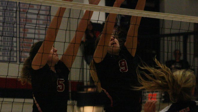 Churchill's Maddie Darling and Sam Zonca get up for a block.