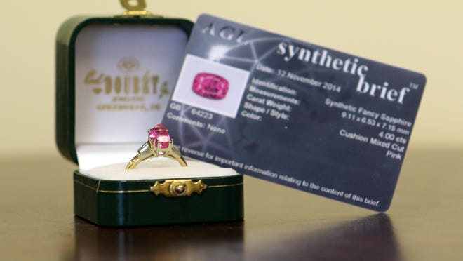 In 1999, Samuel Frabizzio purchased a pink sapphire gemstone from Carl Doubet Jr. Jewelers in Greenville for $9,000 and had it set in a 14 karat gold ring with six diamond baguettes for a total cost of $12,000. After having the gemstone analyzed late last year, he was told the stone was man-made in a laboratory and worth only $30. He thought it was worth $37,500.