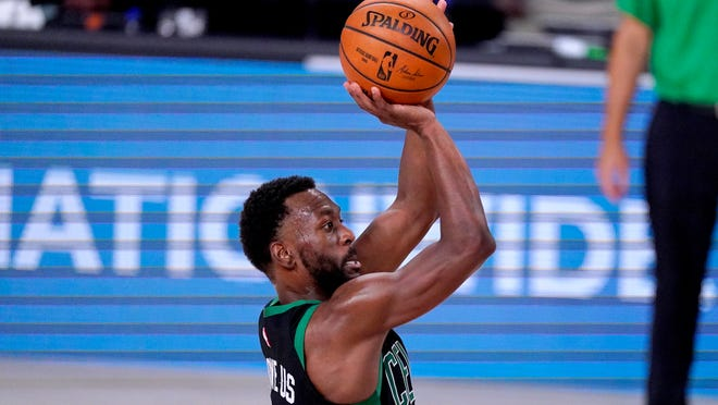 Boston Celtics' Kemba Walker shoots against the Toronto Raptors during the second half of an NBA conference semifinal playoff basketball game Friday, Sept. 11, 2020, in Lake Buena Vista, Fla.