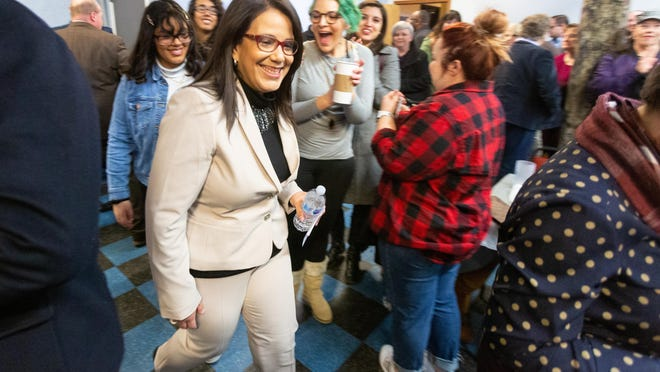 Mayor Michelle De La Isla, here campaigning in Topeka, will have to balance engaging voters in rural and urban parts of the 2nd Congressional District.