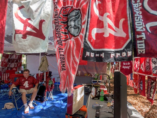 Kevin Crawford watches football while tailgating on